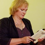 Editor Sally Flint reads at the launch